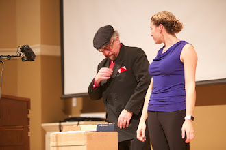 Photo: Jamy demonstrating three-card Monte with Jo