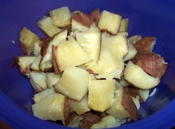 Prepare the potatoes. I wash, cut a slit in each potato and place in...
