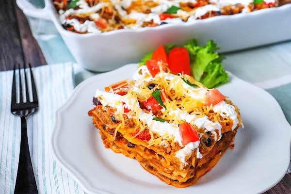 Slice Of Mexican Lasagna On A Plate.
