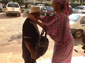Photo: Arrival of Participants-LOC Chair, Dr Nwajiaku adorns Prof Emenyonu with Conference Badge