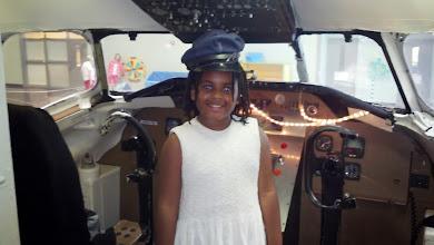 Photo: w/ her pilot's hat