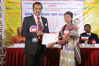 Photo: Prof. Dr. R. Ganesan, Chairman, NFED Issuing Certificate of Appreciation To Ms. Dhanam Easwaran, Research Analyst, Bonfring, Coimbatore