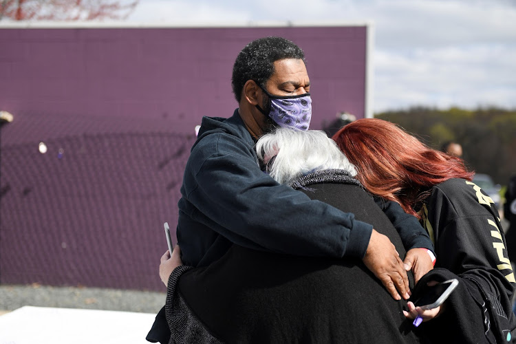 Ali Rashid embraces his wife Barbara Rogers and their friend Sara Nameth at Paisley Park on the fifth anniversary of Prince's death.