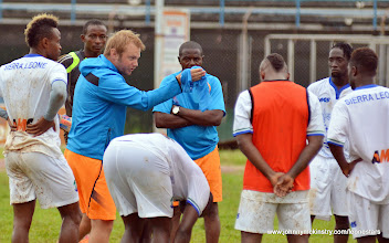 Photo: Tom Harris (Assistant Coach) and Tamba Moses (Goalkeeping coach) working with the Leone Stars  [Training Camp ahead of Leone Stars v Seychelles Game in Freetown on 19 July 2014 (Pic: Darren McKinstry)]