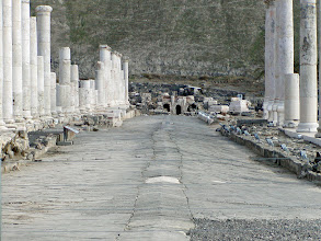 Photo: A wide colonnaded Roman street leading to the theater