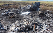 Investigators combed through the debris in the aftermath of the crash in Winterton, KwaZulu-Natal.