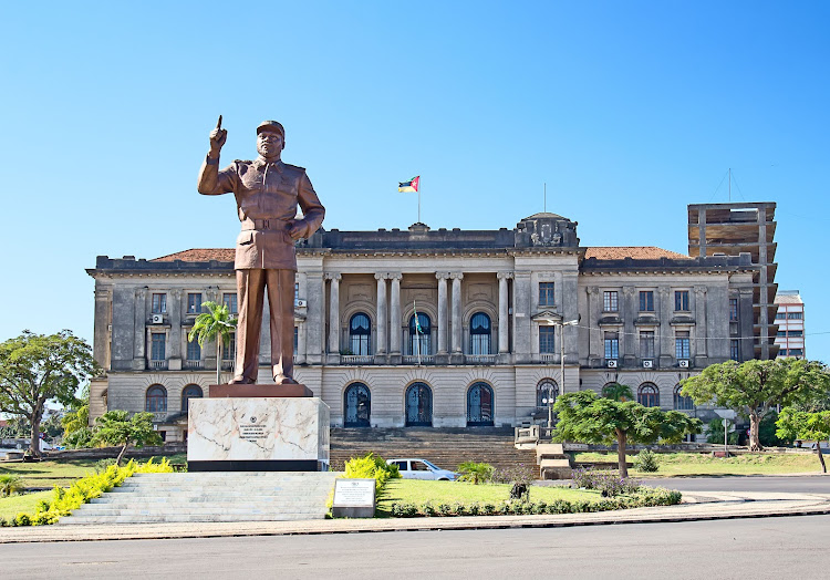Mozambique's City Hall with a statue of Samora Machel