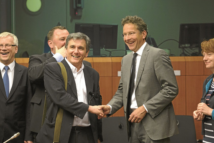 DEBT RELIEF? Dutch finance minister Jeroen Dijsselbloem, right, greets Euclid Tsakalotos, Greece's finance minister, prior to talks. Greece is on the brink of receiving fresh bailout cash, after eurozone finance ministers welcomed its latest package of austerity measures, tax hikes and pension reforms. Debt writedowns may be considered. Picture: BLOOMBERG/JASPER JUINEN