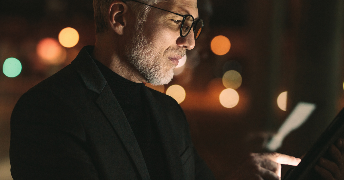 Older Man with glasses using a smartphone