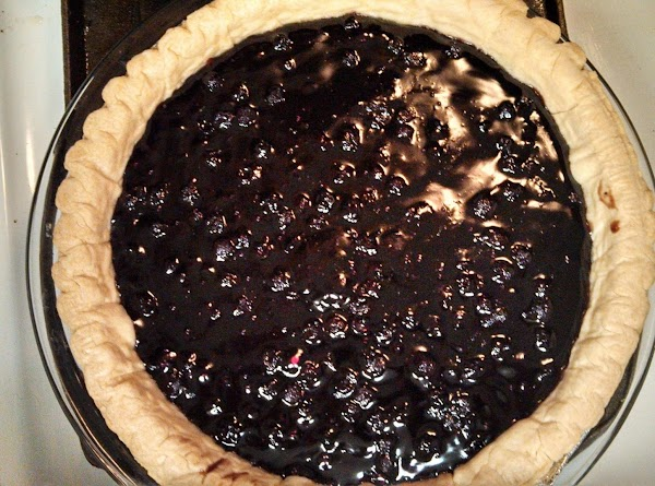 Spoon blueberry mixture into pastry-lined pie pan. Distribute sugar and flour mixture evenly over...