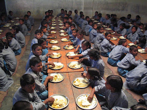 Photo: Hungry young learners tucking into lunch provided by Project Mala
