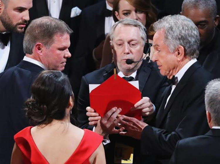 Warren Beatty, moments after he had been made aware of the gaffe. Picture: REUTERS