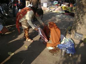 Photo: Team medma distributing blankets to poor people.