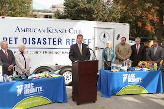 Photo: Tom Sharp (CEO, AKC Reunite)presents the firstAKC Pet Disaster Relief trailer.  Credit: Robert Young (c) American Kennel Club