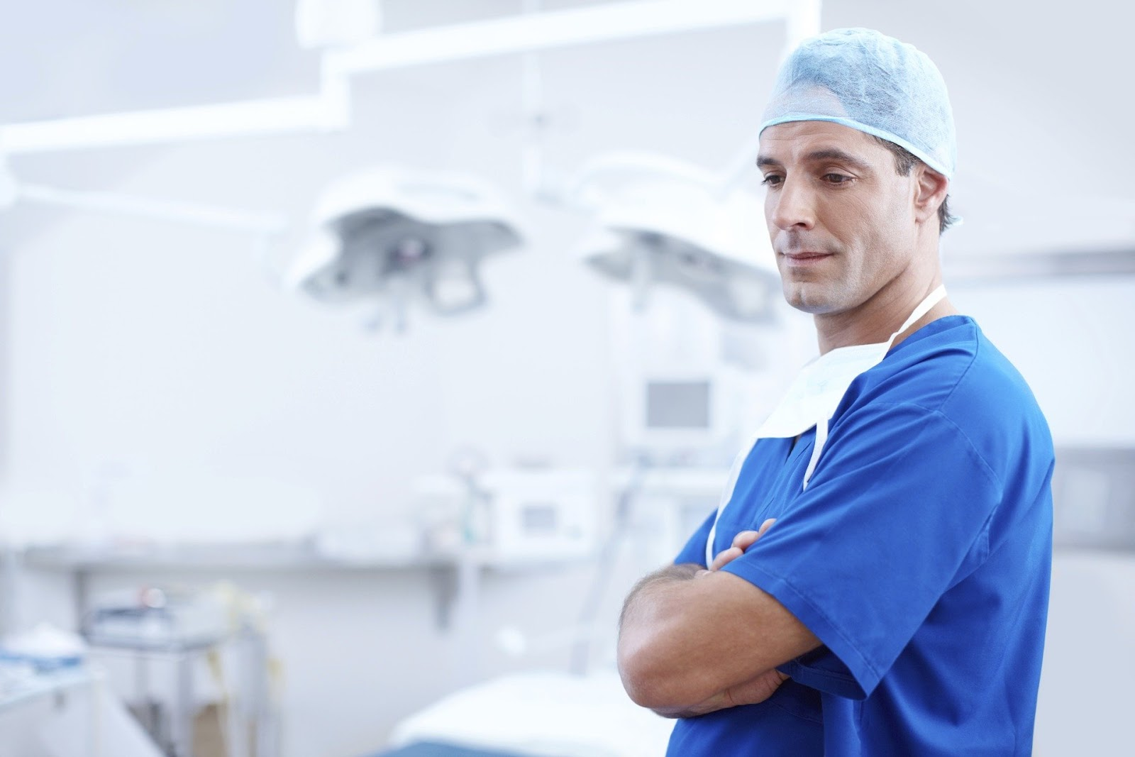 doctor looking down in operating theatre
