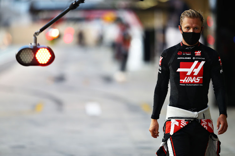 Kevin Magnussen walks in the pit lane during qualifying ahead of the F1 Grand Prix of Abu Dhabi at Yas Marina Circuit on December 12 2020 in Abu Dhabi, United Arab Emirates.
