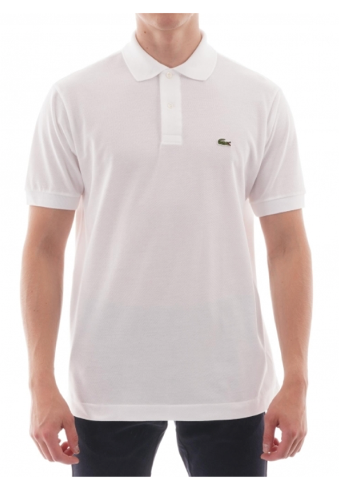 A person wearing a white shirt  Description automatically generated