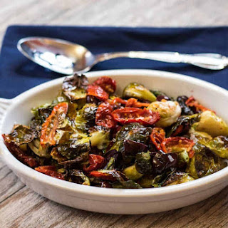 Roasted Brussels sprouts with sun-dried tomatoes and Kalamata olives.