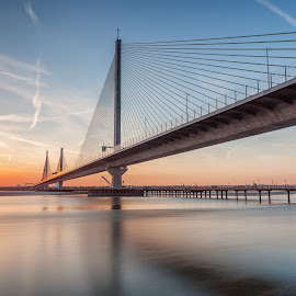 The sun setting over the Mersey Gateway Bridge by Andy Young - Buildings & Architecture Bridges & Suspended Structures ( serenity, river mersey, sunset, tranquility, mersey gateway crossing, orange sky, last light )