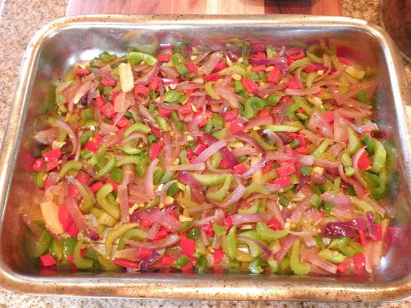 Place all the cooked vegetables on the bottom of a rectangular baking dish. Distribute...
