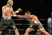 Kevin Lerena   fighting Dmytro Kucher  in the world  title fight in this file picture. Lerena is now after  Thomas Oosthuizen.