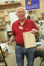 Photo: And last-month's demo piece, a notebook cover by David Reed Smith, is won by an equally pleased Bill Long.