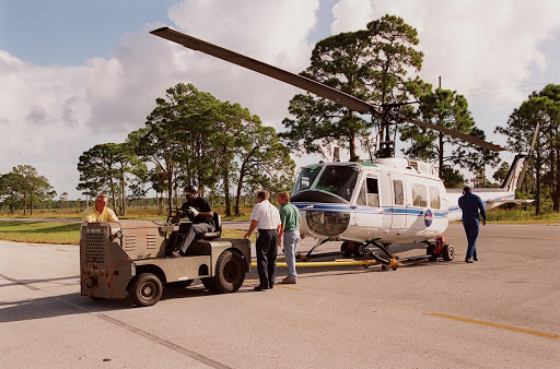 A NASA helicopter is secured for transfer to Ransom Road at KSC.