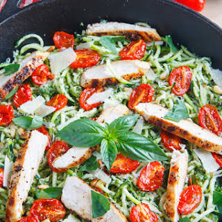 Pesto Zucchini Noodles with Roasted Tomatoes and Grilled Chicken.