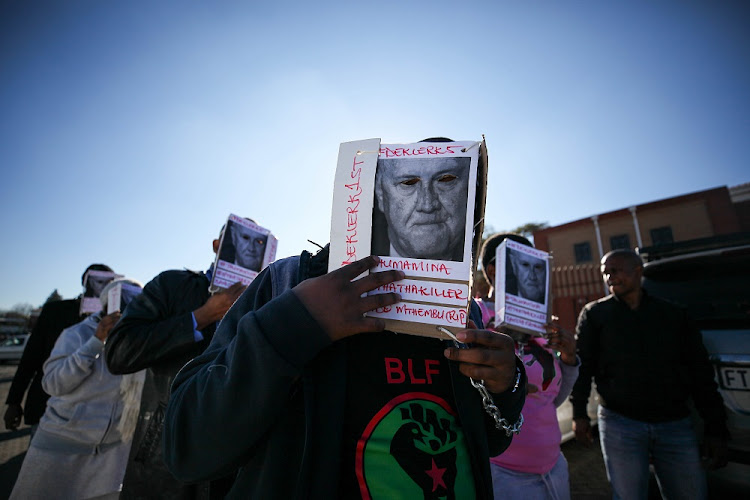 Members of the Black First Land First (BLF) call for former president F.W de Klerk's arrest after a court appearance by Duduzane Zuma at the Randburg Magistrates court, Johannesburg,