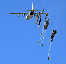 Photo: A C-130 Hercules drops supplies to International Security Assistance Forces assigned to Forward Operating Base Sweeney, Zabul Province, Afghanistan, Feb. 7. Winds during the drop gusted up to 20mph. (U.S. Air Force photo/Staff Sgt. Brian Ferguson)(Released)
