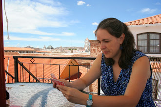 Photo: Playing cards on the terrace, with the Plaza Principal in the background