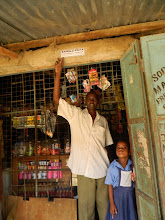 Photo: BBN Member shop-keeper working with Bangla-Pesahttp://koru.or.ke
