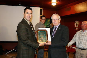 Photo: John Dugan received the Distinguished Fifty Year Member award from Society this past year and here he is presented with the official plaque.