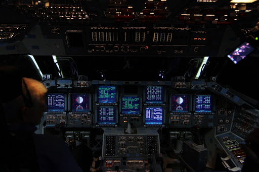 Walter ``Buddy'' McKenzie monitors the consoles on space shuttle Endeavour's flight deck to power down the shuttle for the final time get under way.