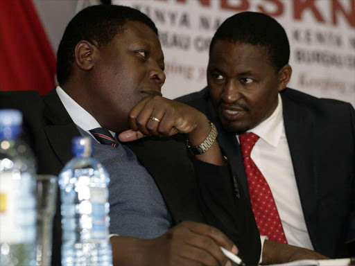 Devolution Cabinet Secretary Eugene Wamalwa with his Agriculture counterpart Mwangi Kiunjuri at the release of the 2016 Economic Survey Report in Nairobi, May 3, 2016.