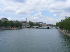 Photo: The serene view down the Seine from the pedestrian Pont de Arts. The first metal bridge in Paris was completed at this location in 1804. However, damage from boat collisions and two world wars led to its closing in 1977, with the current bridge, built to preserve the style of the original, opening in 1984.