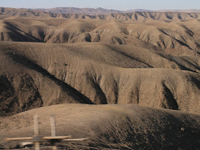 Photo: It's dry here, but you can tell it actually does rain because there are gullies. Closer to the coast in the Atacama, there were no gullies - the smooth curves of the landscape look like another world.