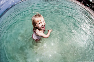"""Photo: Magical water I can almost hear she is saying """"Papa, this water is magical!"""". Top-down portrait with fisheye, in the middle ofCaribbeansea, and creative use of post-production time: what could be more magical for a photographer?  BTW, there are many good tutorials about post prodcution from my photoshop lady, +Genia Larionova(she processed this image) here, take a look:http://goo.gl/DHQhG"""