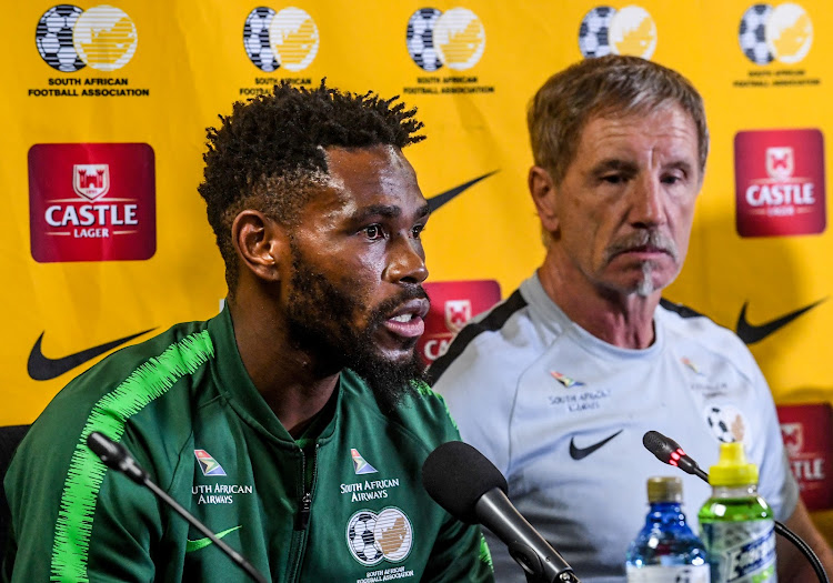 Thulani Hlatshwayo (captain) and Stuart Baxter (coach) of Bafana Bafana during the South African national soccer team arrival press conference at OR Tambo International Airport on March 26, 2019 in Johannesburg, South Africa.