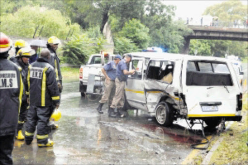 AFTERMATH: A minibus taxi collided with a Mazda 323 sedan in Barry Hertzog Avenue in Emmarentia, western Johannesburg.Pic. PETER MOGAKI. 25/02/2010. © Sowetan.  20100225PMO:Taxi lost control and collided with Mazda sedan at Berry Hertzog in Emarentia, west of Johannesburg.PHOTO:PETER MOGAKI