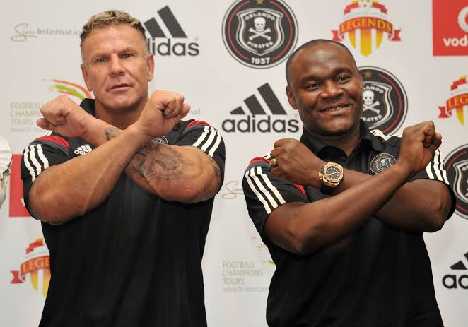 Former Orlando Pirates' striker Marc Batchelor (L) with his former teammate and goalkeeper William Okpara (R). Batchelor died in a hail of bullets outside his Johannesburg home on Monday July 15 2019.