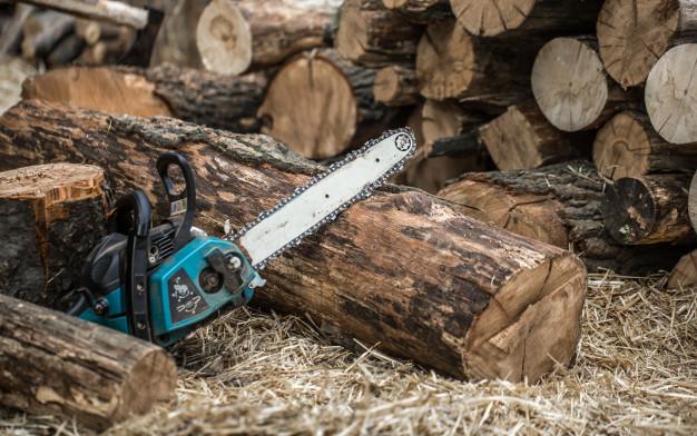 Man cutting wood log
