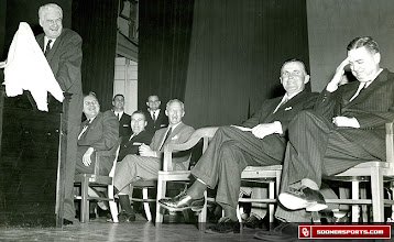 Photo: This photo was taken in OU's Holmberg Hall on Feb. 22, 1956, when the Sooners were receiving the Grantland Rice Trophy for the 1955 National Championship. Dan Mich, vice-president of Look Magazine, just commented that Look Sports Editor Tim Cohane, seated far right, had picked Maryland to win the national championship for 1955. From left to right are Mich, at the podium, Oklahoma Governor Raymond Gary, Chet Francis (seated), Wilkinson, Cross and Cohane.
