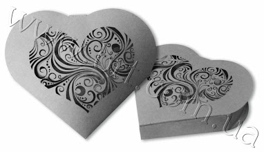Photo: Упаковка для подарков в форме сердца. Сложный узор высечен с помощью лазера