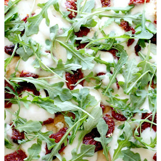 Focaccia Pizza with Sun-dried Tomatoes and Arugula.