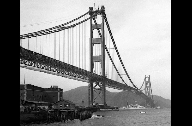 Photo: The Golden Gate Bridge, nearly complete on November 12, 1936. The warship seen passing under the bridge was on its way to attend the opening of the Oakland Bay Bridge. (AP Photo)