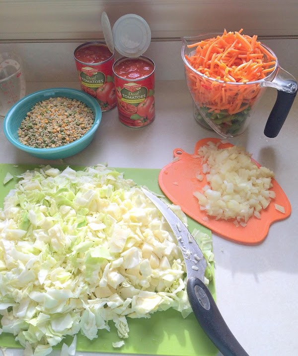 Add 2 cups diced carrots, 3 stalks chopped celery, 2 cups of green beans...