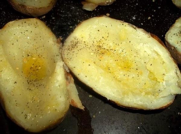 Place the potato halves on a sheet pan.   I then brushed the inside of each...