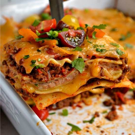 This Family Friendly Mexican Lasagna With Layers Of Melted Cheese, Taco Seasoned  Ground Beef, And Creamy Refried Beans Is Sure To Please.