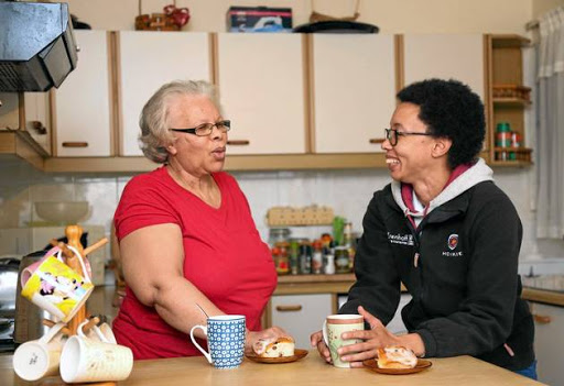 Durban teacher Lenise Marais, right, with her mother Ann in the kitchen of the home they share.